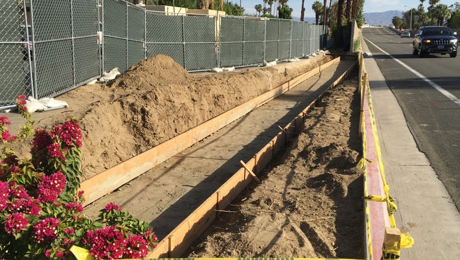 A sound wall is being downsized along Gene Autry Trail in Palm Springs. Drivers say it's blocked their view of oncoming traffic and they're already seeing improvements even though work isn't done.