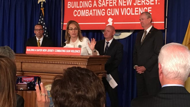 Former U.S. Rep. Gabrielle Giffords spoke briefly Monday during a news conference to name Bill Castner, left, a senior adviser to Gov. Phil Murphy on gun violence prevention efforts.