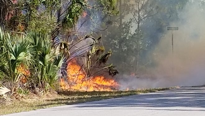 A number of units were fighting a 22-acre brush fire along Jennings Street in the Gulf Cove section of Charlotte County on Monday evening.