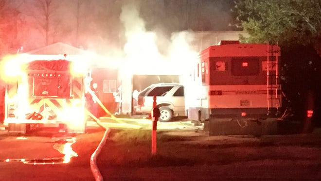 Firefighters are investigating a house fire on Dove Road in Port Huron Township Monday night. Two dogs died in the fire.