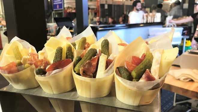 Cones full of cheeses, pickles and cured meats are among dishes served by Oca at Sun King Brewery in Indianapolis and coming to Sun King's distillery opening July 2 in Carmel.