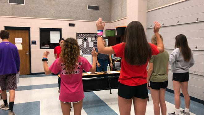 Lafayette Parish athletes go through flexibility testing during Saturday's annual Physicals and Impact Day at David Thibodaux High.