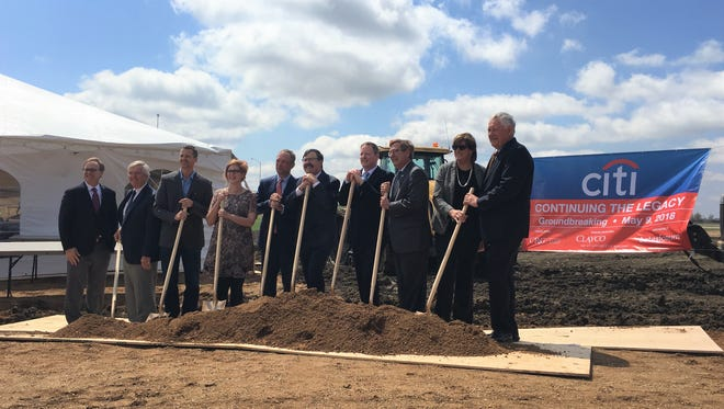 Dignitaries break ground on the new Sioux Falls campus for Citi in southwest Sioux Falls, on Wednesday.
