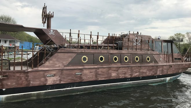 The Helm restaurant in Greenwood Lake, N.Y. recently acquired a knock-off pirate ship to use as a floating billboard and dining area. The steel boat is painted brown and adorned with various ship's wheels and skulls.