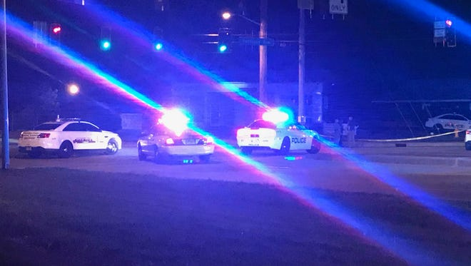Evansville police cars block Diamond Avenue at intersection with Kentucky Avenue after a fatal shooting Friday night.