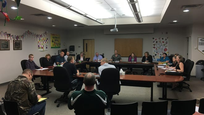 Community leaders from both sides of the Sauk Rapids-Rice referendum campaign address the school board on Monday night.