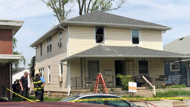 Firefighters from Beech Grove and Indianapolis worked together to fight a fire that killed a child and hurt two others.