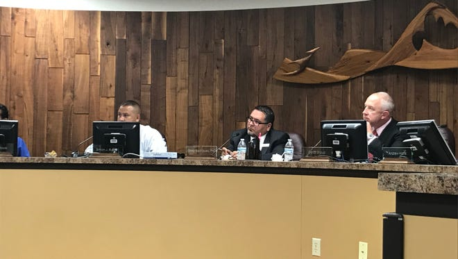 Carlsbad school board member Simon Rubio, left, Carlsbad Superintendent Dr. Gregory Rodriguez, and president of the Carlsbad School board David Shoup listen to public comments May 15.