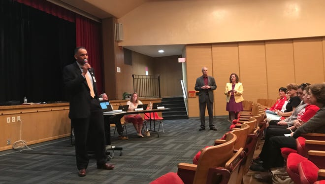 Manitowoc Superintendent Mark Holzman speaks during a public listening session about the proposed school realignment plan at Wilson Junior High auditorium May 15.
