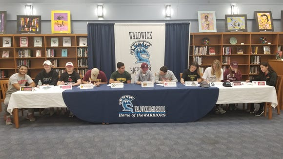 Waldwick signing day: from right, Sonny DiPasquale, Devin Dubrowski, Will Frederic, Max Forrest, Brad Gelles, Joe Parsons, Matt Rypkema, Leslie Torres, Jessica Turner, Christina Sullivan, Kiara Zavala.