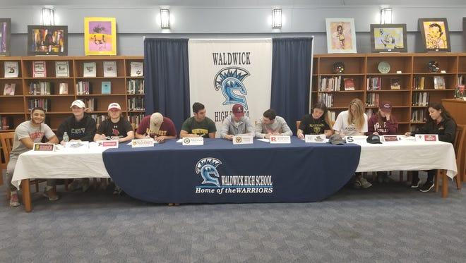 Waldwick signing day: from right, Sonny DiPasquale, Devin Dubrowski, Will Frederic, Max Forrest, Brad Gelles, Joe Parsons, Matt Rypkema, Leslie Torres, Jessica Turner, Christina Sullivan, Kiara Zavala.