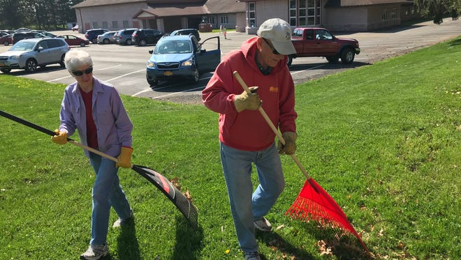 Janice Updike and her husband Marshall stay safe in the sun while volunteering at the United Methodist Church in Horseheads.
