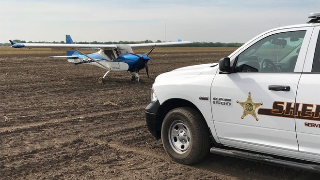 Two people in this plane safely landed in a bean field southwest of the Purdue Airport after the plane lost power, according to t he sheriff's office.