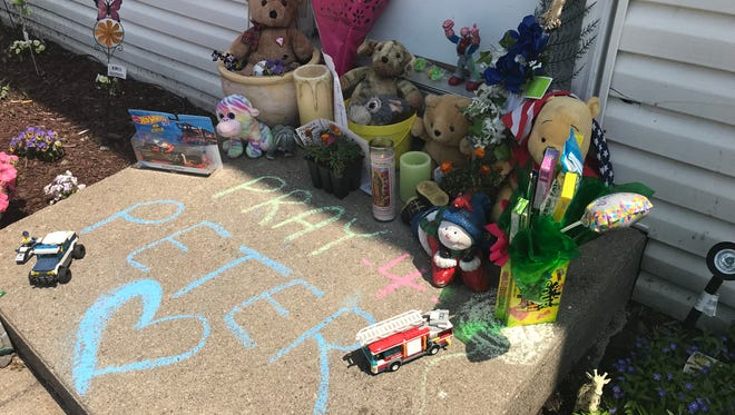 """A memorial for 3-year-old Panagiotis """"Peter"""" Stephanides-Vacchino outside his townhome in Seneca Falls. Peter's mother and stepfather are charged in his death."""