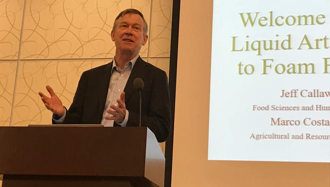 Colorado governor John Hickenlooper speaks to the Liquid Arts Forum at the Lincoln Center in Fort Collins.