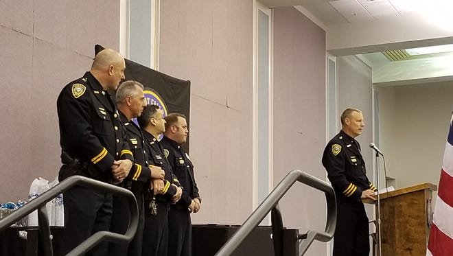 Great Falls Police captains John Schaffer, Jeff Newton, Rob Moccasin and Lt. Doug Mahlum take the stage as Chief Dave Bowen speaks at the annual awards banquet at the Civic Center Convention Center.