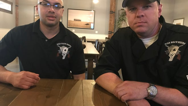 Joseph Kelley and Anthony Sanchez, future crew members of the U.S.S. South Dakota, pose for a portrait at Josiah's. The two were in Sioux Falls this week learning how to cook South Dakota-style food.