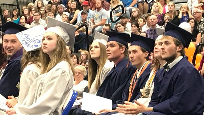 Graduates at Water Canyon High School in Hildale celebrate at the school Monday, May 21, 2018.