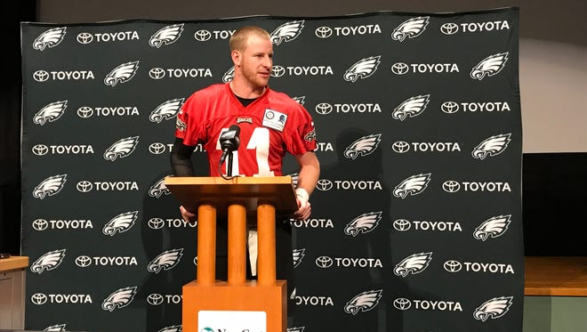 "Eagles quarterback Carson Wentz said he's ""getting antsy"" about returning from torn knee ligaments, but won't rush back. He's not cleared to practice yet."