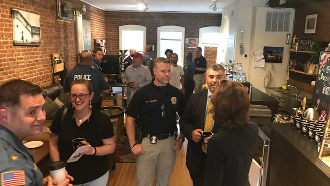 Police hosts visitors to the Boonton Police Department's Coffee with a Cop event at the Boonton Coffee Co. May 22, 2018.