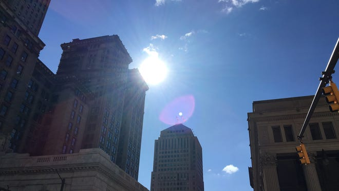 Sun shines on Downtown Detroit.