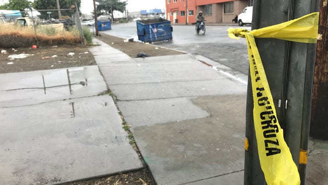 Police tape remains near where a man was stabbed at Bridge Alley and Lake Street.