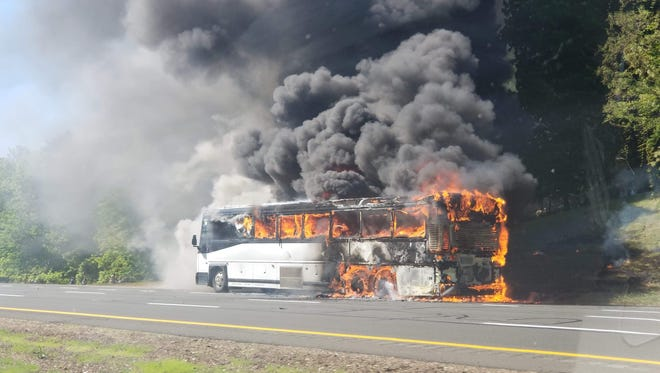 Bus fire on the Garden State Parkway local lanes southbound north of Exit 116.