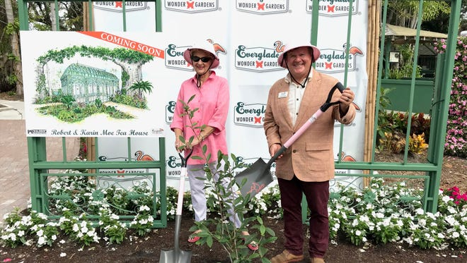 Karin Moe, donor, and Thomas Hecker, executive director of the Bonita Springs Everglades Wonder Gardens, plant a tea tree at the site of a new tea house.