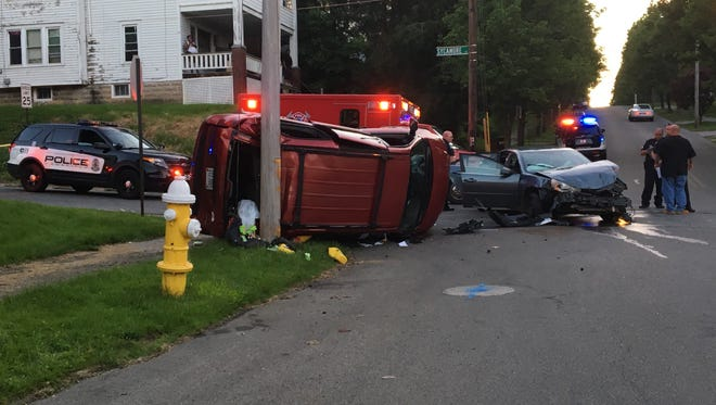 A father and child were injured in a crash at West Third and Sycamore streets on Thursday, May 24, 2018. The driver of the sedan will be cited after running a stop sign and striking the van, police reported.