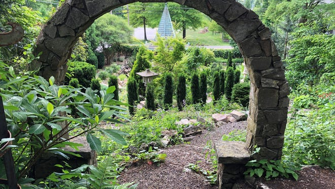 """There is always something to discover in the garden, according to Bill Dohm. """"There is a lot of stonework, and so much blooms even in the winter."""""""