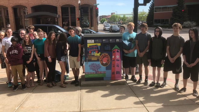 Neenah High School art students partnered with the Neenah Historical Society to paint an electrical control box.