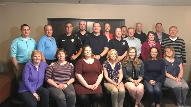 The Citizens Academy class of 2018 poses with officers from the Manitowoc Police Department during the Citizens Academy graduation May 22.