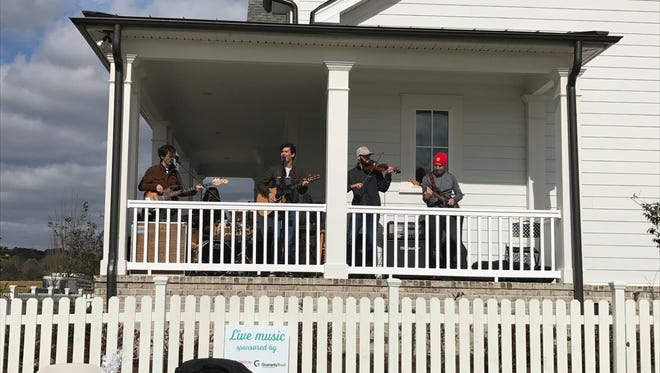 Country artist Tyler Brent and his band play on the porch of a home during an outdoor performance at Durham Farms. The neighborhood's next concert is June 2. The public is invited.