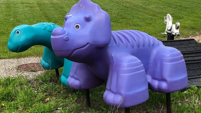 This plastic purple dinosaur was stolen from the Thiensville public works yard on Sunday, May 20.