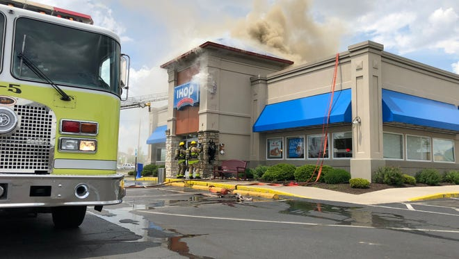 Firefighters battle a blaze at the Muncie IHOP the afternoon of Monday, May 28, 2018.