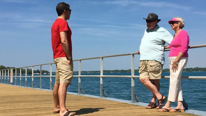 Harriett Marenas, of Rochester, talks with fellow visitors Charlie Ammon and Steve Smith, left, at St. Clair's newly reconstructed boardwalk on Friday, May 25, 2018.