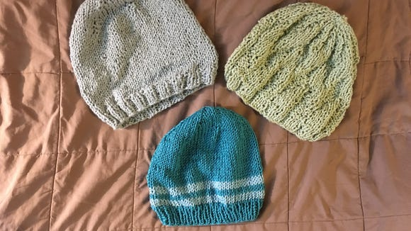 I knitted all these on size 9 needles. The top two are made in a cotton bouclet yarn from Knit One, Stitch Too. The bottom hat, my favorite, is in Berroco Pima Cotton.