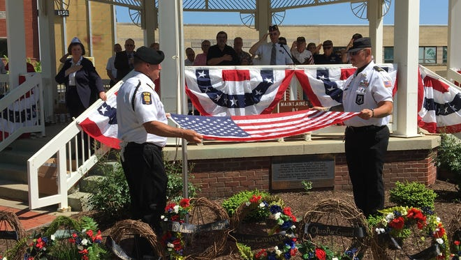 Members of the VFW Post 3494 Color Guard retire the colors after last year's Mansfield Memorial Day ceremony.