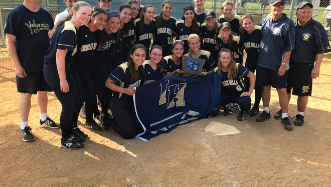 Indian Hills celebrates its North 1, Group 3 sectional softball title.
