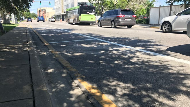 What was a left-turn lane is now seven parking spaces on East Garden Street.