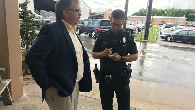 Ned Horton speaks with police following a dispute between Horton and an outspoken supporter of the city's fairgrounds at public meeting on a new fairgrounds master plan on Tuesday, May 29, 2018.