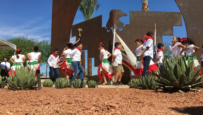 Students of Cesar Chavez Elementary School performing folkloric dances in front of the newly erected monument in honor of Cesar Chavez and the United Farm Workers in De Oro Park, Coachella.