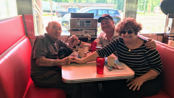 "(From left) Emil ""Speed"" Dandrea, who turned 101 on May 24, celebrates with Joseph Baruffi and Vera Baruffi Sharp on May 25 at the Buena 54 Diner."