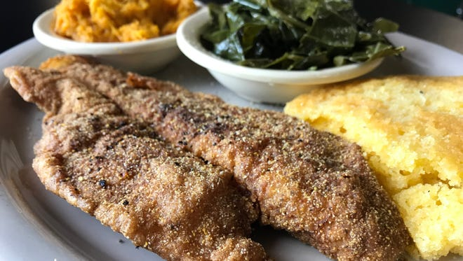 Catfish with sides of sweet potatoes, greens and cornbread at Homemade Southern Cuisine.