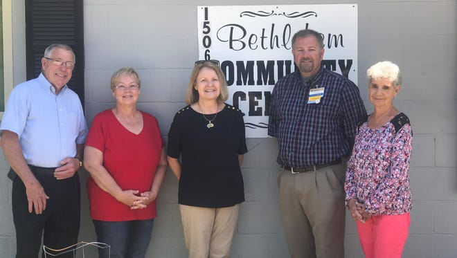 Ted Kerley, Debra Williams, Norma Binkley, Chad Phillips and Martha West convene at the Bethlehem Community Center in Ashland City. Phillips, store manager of the Ashland City Walmart, selected the community center to receive funding through a grant program to help with renovations.