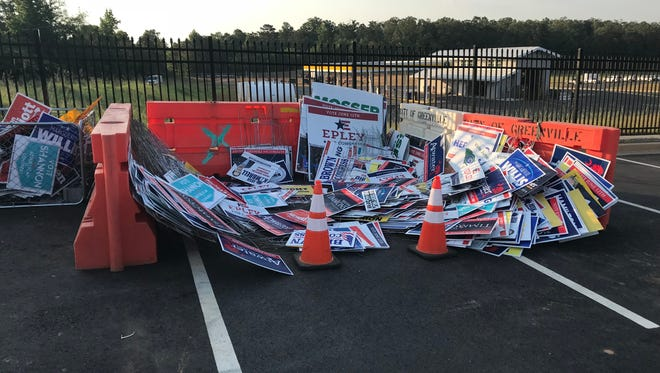 A pile of campaign signs picked up by the City of Greenville sits outside of the Public Works facility on Fairforest Way. June 8, 2018
