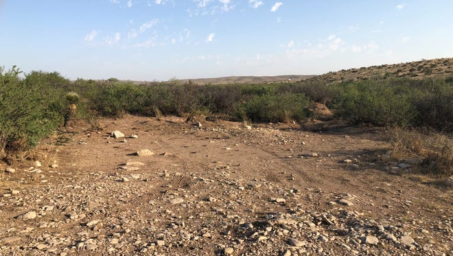 An area of the La Cueva Trail system once covered in debris was cleared by employees of BLM, Wescom Inc. and Marathon Oil June 8.