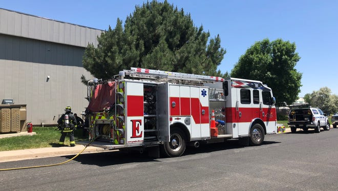 Poudre Fire hazmat crews respond to a report of a fire Saturday, June 9, 2018, at Fort Collins business Wasson-ECE.