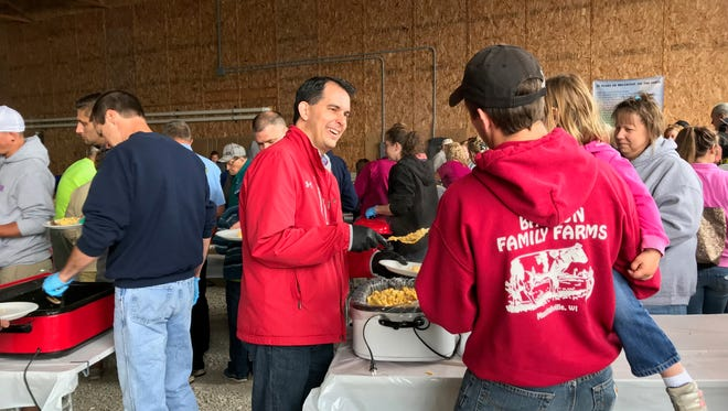 Gov. Scott Walker serves eggs during the Breakfast on the Farm event at United Vision Dairy June 10.