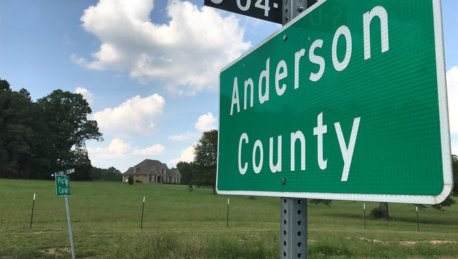 Pickens County assessors, armed with tape measures, paid unexpected visits to a couple dozen erstwhile Anderson County homeowners last week with the news that they were now Pickens County residents.